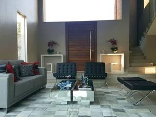 Living: Salas de estar  por Cintia Abreu - Arquitetura e Interiores