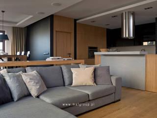 MAFGROUP_MIESZKANIE W WARSZAWIE_100M2: styl , w kategorii Salon zaprojektowany przez MAFgroup