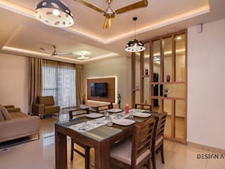 Living Room Interior Apartment Bangalore:  Living room by Design Arc Interiors