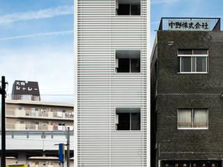 大阪市都島区の共同住宅 株式会社 藤本高志建築設計事務所 モダンな 家 白色