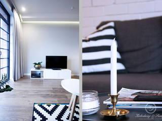 KONESER: styl , w kategorii Salon zaprojektowany przez Kołodziej & Szmyt Projektowanie wnętrz