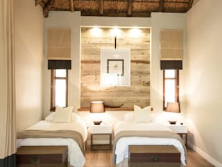 Corporate game lodge in Welgevonden game reserve:  Hotels by Kim H Interior Design