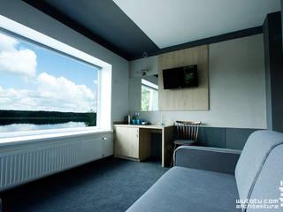 Salon główny z częścią sypialną: styl , w kategorii Salon zaprojektowany przez WUTOTU architektura