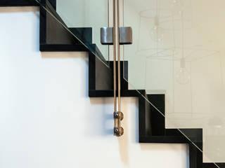 غرفة المعيشة تنفيذ SPAZIODABITARE architects, تبسيطي