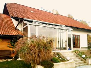 Sommergarten aus Aluminium-Schiebeelementen Schmidinger Wintergärten, Fenster & Verglasungen Moderner Wintergarten Aluminium/Zink Metallic/Silber