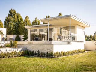 Poolhaus mit Schiebeverglasungen von Fenster-Schmidinger Schmidinger Wintergärten, Fenster & Verglasungen Moderne Fenster & Türen Glas Transparent