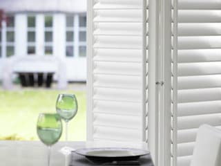 Lifetime Vinyl Guide and Glide Door Shutters.: classic Dining room by Thomas Sanderson