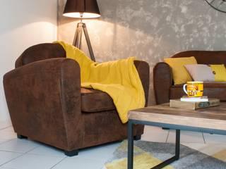 Fauteuil club: Salon de style de style Industriel par Carnets Libellule