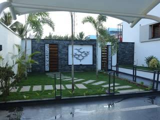 East garden:  Garden by Hasta architects