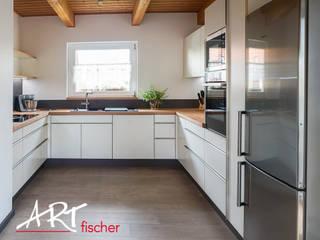 ARTfischer Die Möbelmanufaktur. Modern style kitchen Wood White