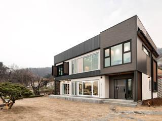 Casas modernas por 코원하우스