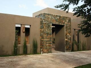 Rocha & Figueroa Bunge arquitectos Casas rústicas