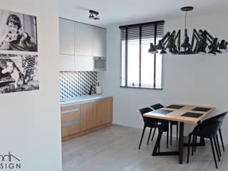 Mieszkanie dla wielbiciela Salvadora Dali: styl , w kategorii Kuchnia zaprojektowany przez studio projektowe KODA design Dawid Kotuła