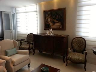 Living Clássico: Salas de estar  por Cintia Abreu - Arquitetura e Interiores