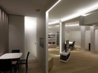 Spirale avvolgente Soggiorno minimalista di Enrico Realacci Architectures Minimalista
