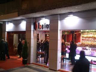 Comercio Embutidos Ballesteros: Casas de estilo  de LM PROYECTOS