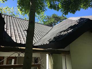 Onduvilla tiled roof: modern Houses by Cintsa Thatching & Roofing