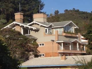 Casa II Condomínio Palavra da Vida: Casas campestres por Éfeso Arquitetura & Construção