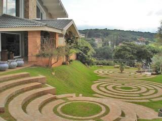 Casa II Condomínio Palavra da Vida: Jardins campestres por Éfeso Arquitetura & Construção