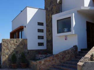 Vivienda L52 Fundo Loreto, La Serena. Territorio Arquitectura y Construccion - La Serena Casas de estilo mediterráneo Concreto Acabado en madera