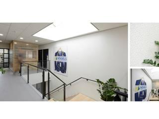 Vogels Bouwmanagement:  Kantoor- & winkelruimten door Studio'OW Interieurontwerp