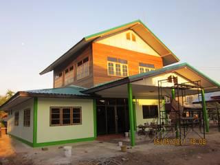 บ้านพักอาศัย 2 ชั้น ครึ่งปูนครึ่งไม้ โดย BSC Construction