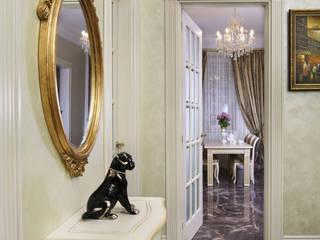 Pasillos, vestíbulos y escaleras clásicas de Дизайн бюро Оксаны Моссур Clásico