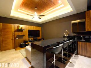 CASA LC: Salas de estilo moderno por UNOCUATRO
