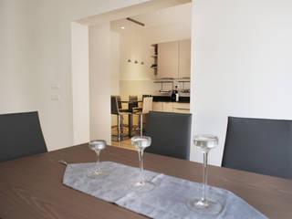 Casa EA Sala da pranzo moderna di Giulia Villani - Studio Guerra Moderno