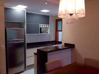 Cozinha integrada: Cozinhas  por DE LA ROCHA ARQUITETURA,Moderno