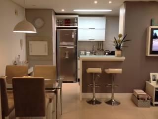 Reforma e ambientação residencial: Salas de jantar  por DE LA ROCHA ARQUITETURA,Moderno