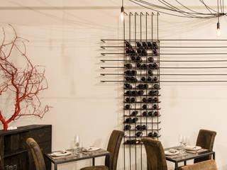 Gran Caffe Belli: Sala da pranzo in stile  di Galleria Interni Arte