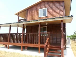 Houses by 鄉村東和鋼構木屋