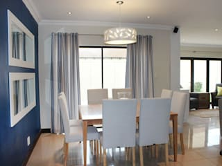 Modern dining room by Covet Design Modern