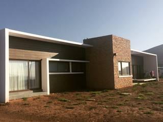 vista casa entregada: Casas de estilo  por Vinci studio
