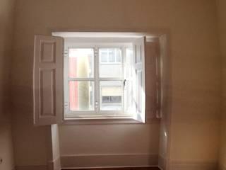 Reabilitação de Apartamento - Lisboa: Quartos  por Vitor Gil, Unip, Lda,Rústico