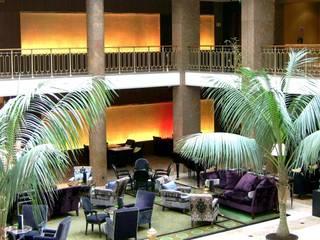 Hotel Tivoli Avenida: Salas de estar clássicas por Conceitos de Arte, Arquitectura e Decoração Lda