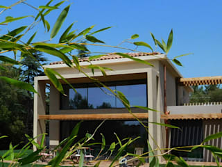 Maisons jumelées: Maisons de style  par Jean-Marc Achy Architecte DPLG,