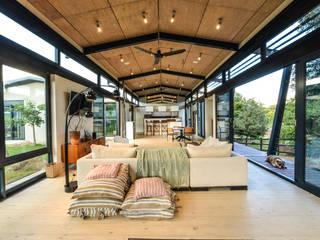 Industriale Wohnzimmer von Studious Architects Industrial