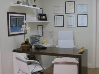 Consultório Odontológico e Quiropraxia: Clínicas  por Paula  Makdissi arquitetura e interiores