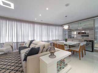 AMBIENTE INTEGRADO: Salas de estar  por AGGA ARQUITETURA E INTERIORES,Moderno