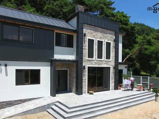 Maisons de style de style Moderne par 꿈애하우징