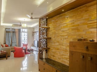 3 BHK partement :  Living room by In Built Concepts