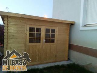 Caseta de madera Mary:  de estilo  de MI CASA DE MADERA - SOLICITA PRESUPUESTO info@micasademadera.com