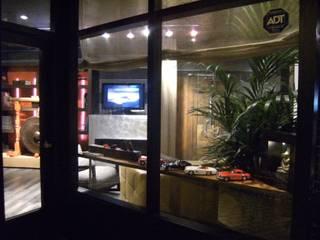 Local comercial INTERIORISMO: Estudios y despachos de estilo  de L'ANTIGA PRIMILIA