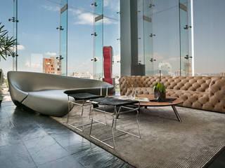 Salones de estilo moderno de M+M INTERIORISMO Moderno
