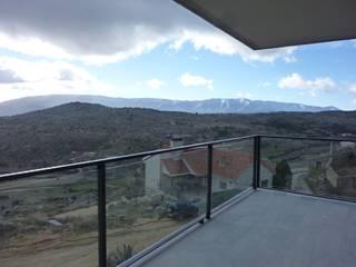 Viviendas Unifamiliares en la provincia de Ávila Balcones y terrazas de estilo rural de E.PARADINAS·ARQUITECTO Rural