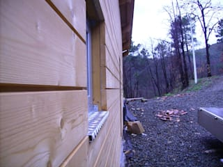 Casa in legno Case moderne di Studiopp8 Moderno