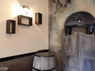 Restyling ristorante: Spazi commerciali in stile  di Meraki di Irene Mancini