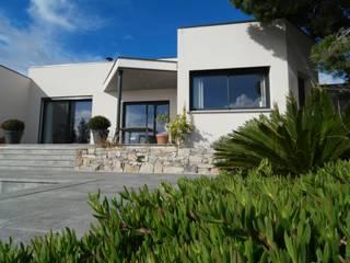 Villa carrée: Maisons de plain-pied de style  par Amélie Soriano